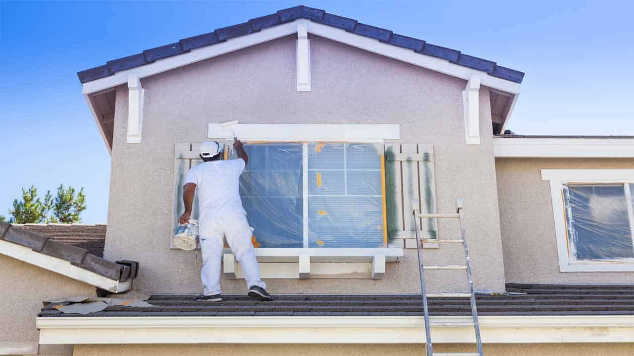 If you are wondering how to paint the exterior of a house with a sprayer then you are in the right place. We have made a small but effective guide on how you can do that. All you need is a tape, a paint sprayer, and two buckets of exterior paint.