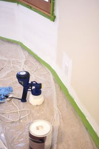 painting walls with paint sprayers