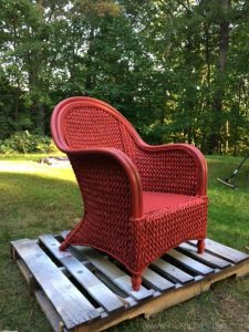 A piece of red furniture that has been spray painted by the best paint sprayers for home use. Clearly, you can see the quality that these paint sprayers provide. You can make all your furniture look like this using the Best Paint sprayer for House Exterior