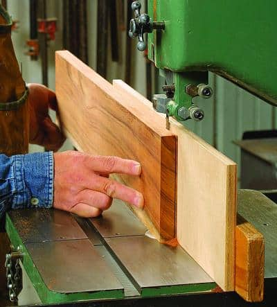 If you want to work with thick wood objects, then you should always buy a band saw instead of a scroll saw. They are more powerful and can handle almost every material.