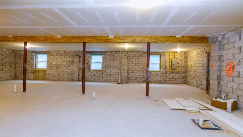 You need to clean the basement floor and remove anything that could get into your way while painting. If you can't remove something then you should cover it.