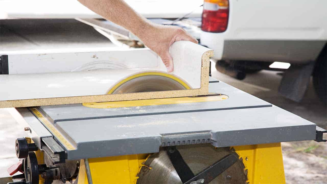 A table saw is a power saw that is used mostly to cut wood. It comes with a table and a blade at the center of the table. You have to push the materials through that blade to get a cut. Table saws can be very bulky, so if you decide to buy one then make sure to have a large space in your garage.