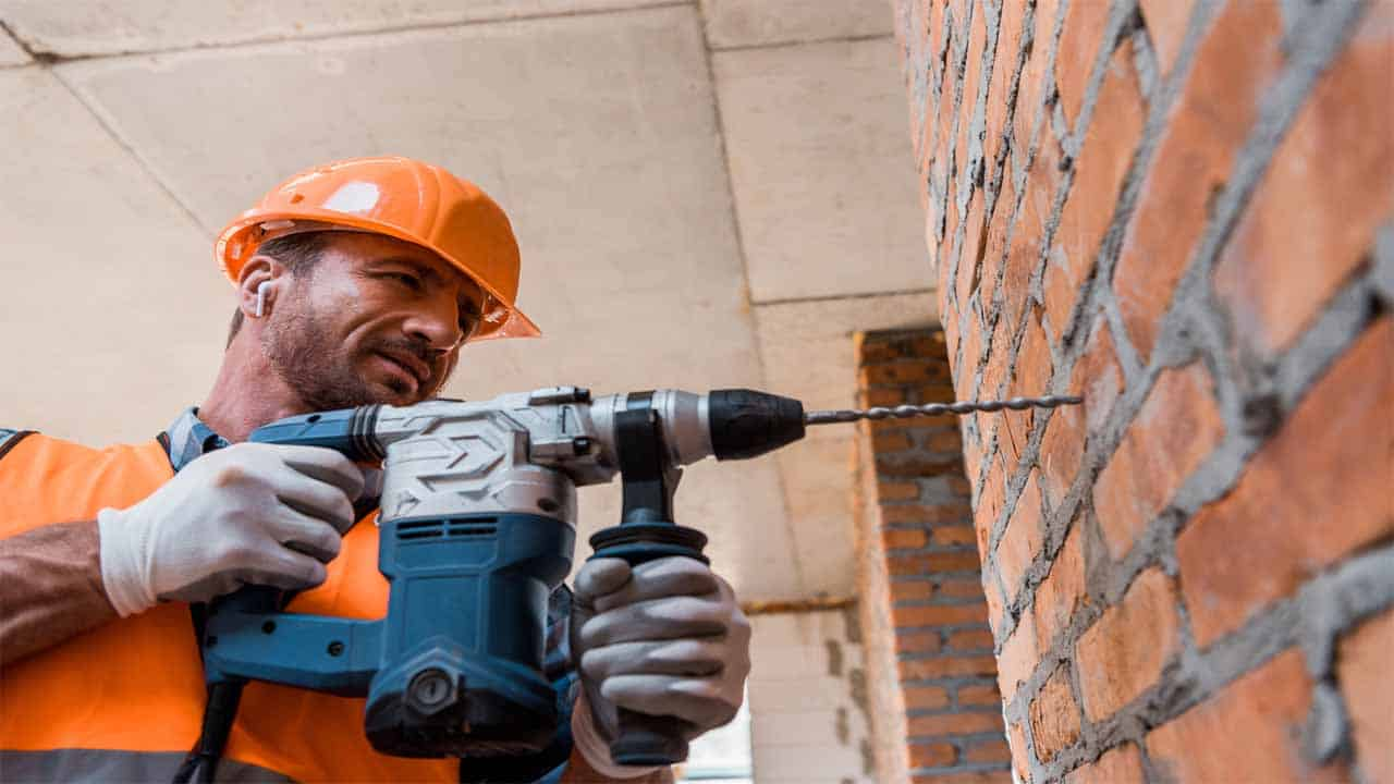 Not everyone knows how to drill through bricks. Bricks can easily break and make a huge mess so being careful is the first step. To do this, you need to have the right tools, using a normal drill won't cut it, you need a hammer drill that has enough power, the oldest the brick the more power the drill needs to have.