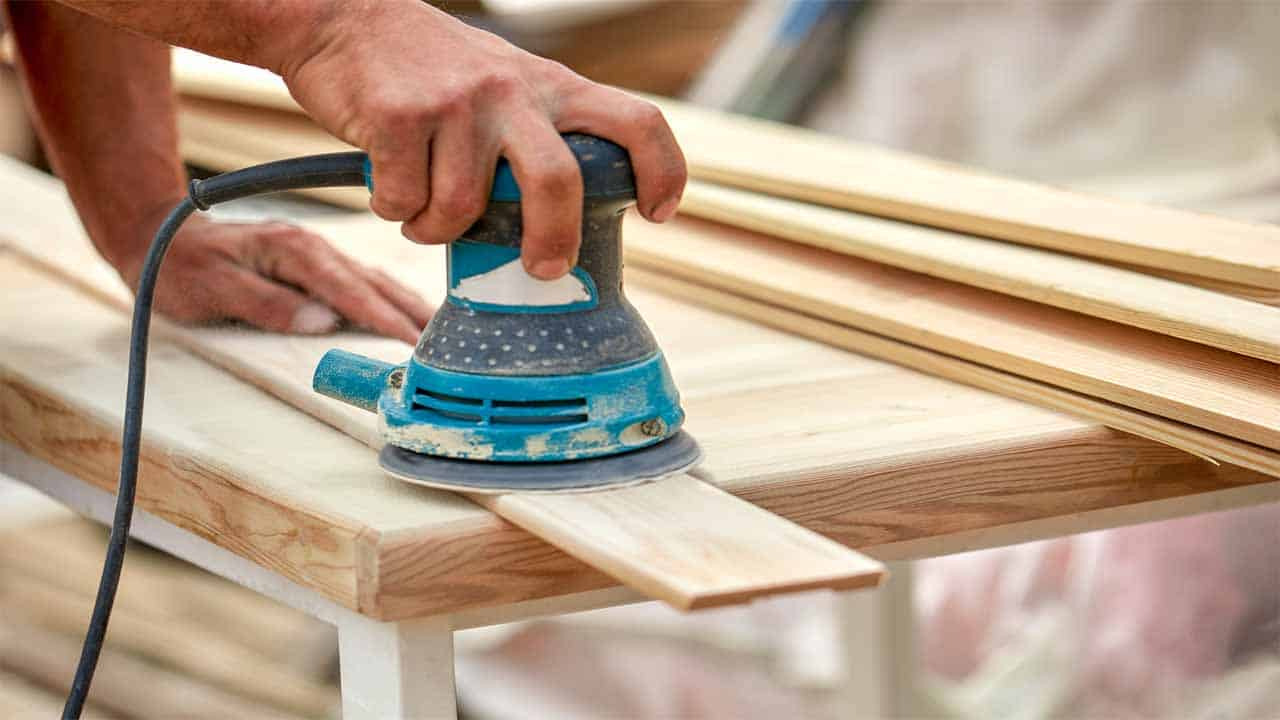 Sanding the surface to remove acrylic paint is a very useful thing to do. Just start the sander on a low-speed and start sanding the surface. Make sure to be careful and not use high-speed because you can easily damage the wood.