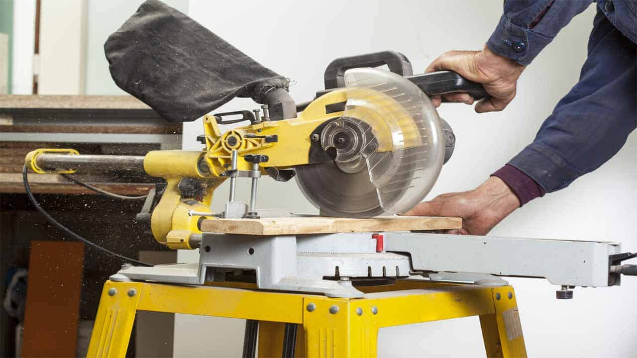 The table saw is a very popular tool amongst professionals. The table saw is mostly used for woodworking projects. It comes with a blade located at the center of the table that spins at a high-speed. To cut the material you have to push the material through the blade. The blade cannot be moved, but you can adjust its height.
