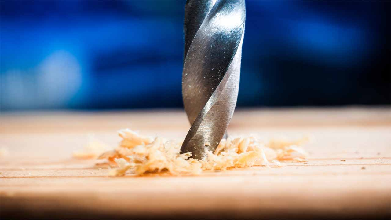 The best way to sharpen drill bits is to use a bench grinder. A bench grinder is a great tool that will sharpen your drill bits within a minute. But, you should check our guide to learn the exact steps on how to do it.