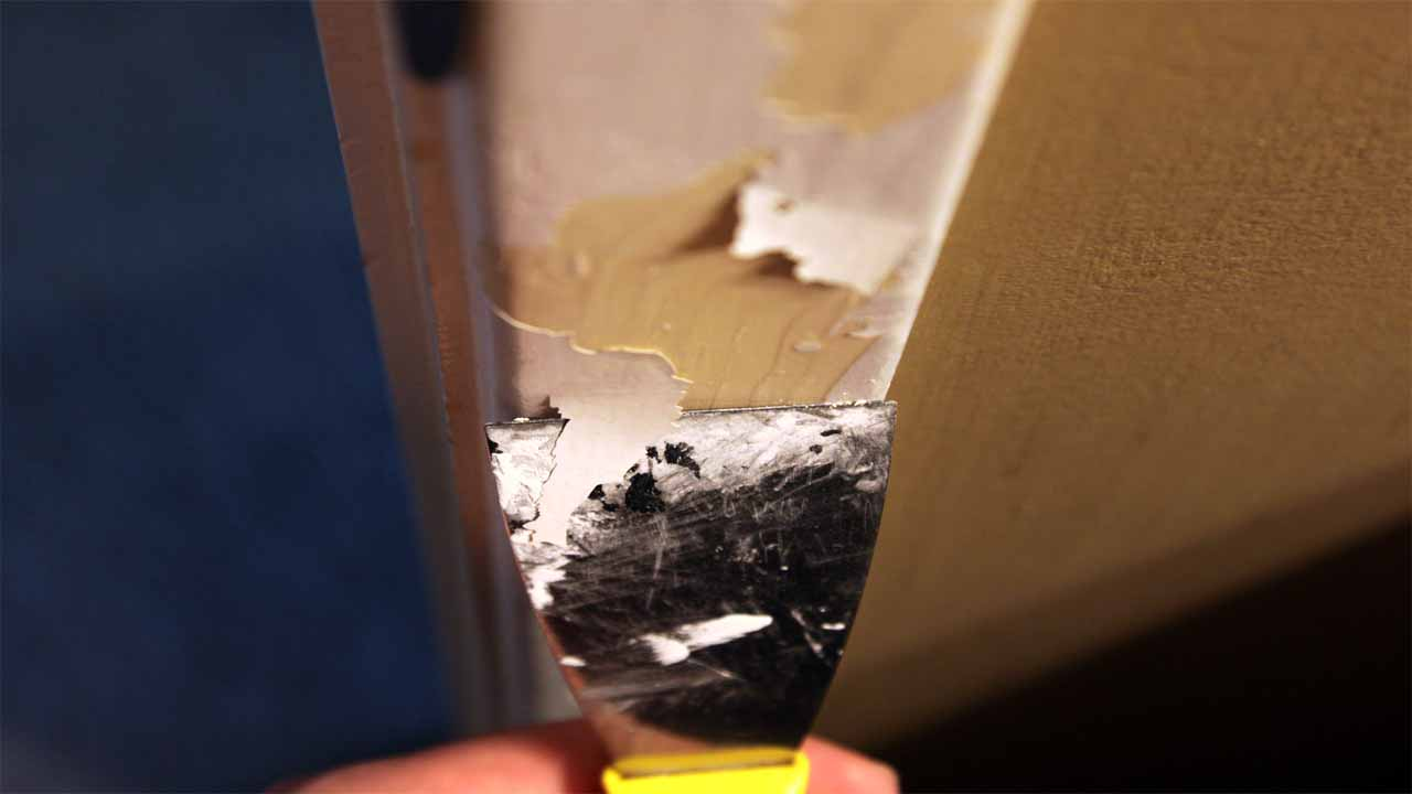 After you apply the paint stripper, you should use a knife or a putty knife to scrape the paint off the surface. Although, the paint stripper takes most of the paint off, you still have to scrape the paint that is left with a putty knife.