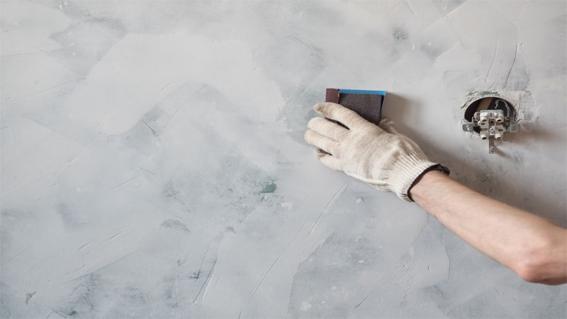 Start sanding the drywall. Start with lower grit sandpaper and then move to a finer one.